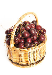 Wicker basket full of cherry berries