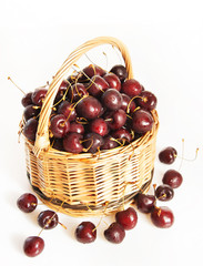 Wicker basket full of ripe cherry