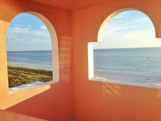 View of ocean and coast framed by windows