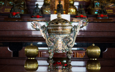 A traditional asian incense burner with a dragon.