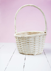 basket on white wood with pink background