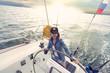 Woman steering yacht b