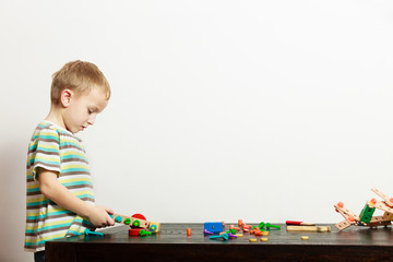 Boy child kid preschooler playing with building