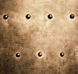 Grunge gold brown metal plate rivets screws background texture