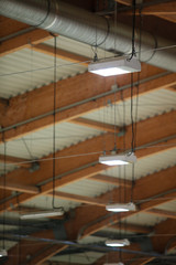 Group of lamps on sport stadium celling. Light power energy