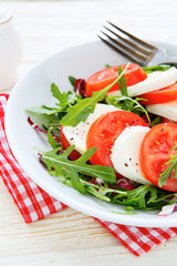 fresh Caprese salad with arugula