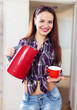 pretty housewife with red tea kettle and cup