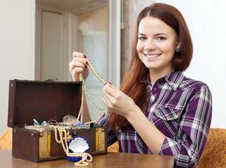 pretty girl chooses jewelry