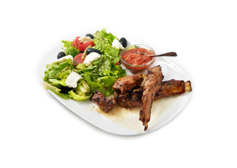 the ribs on the grill with salad