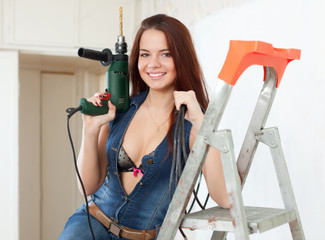 Sexy girl makes repairs at home
