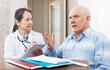mature doctor talks with  senior man