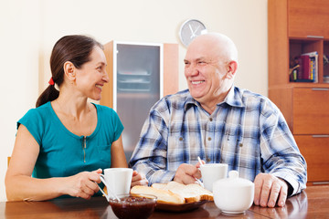 Happy mature couple having tea