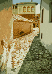 Old street with paving stones expensive. Greece, Kastoria