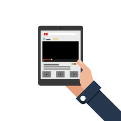 Businessman holding tablet streaming media