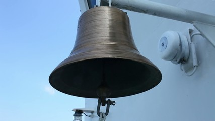 ship's bell  close to with sound