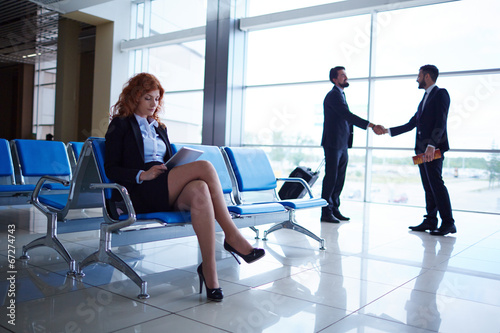 canvas print picture Business people in airport