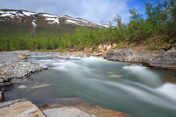 Long exposure of river in the canyon in Abisko National Park.