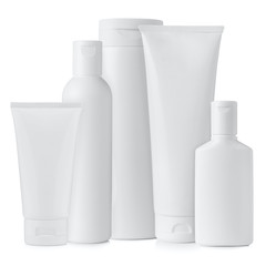 Set of blank white plastic cosmetics bottles isolated