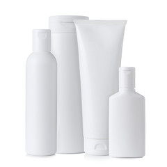 Blank white plastic cosmetics bottles, isolated