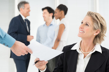 Happy Businesswoman Holding Document
