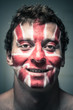 Happy man with British flag on face