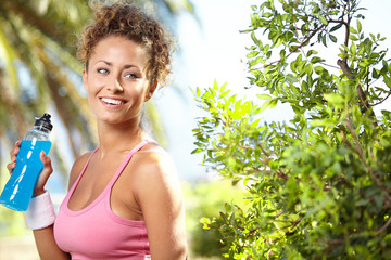 Fit woman in nature.Tropical resort