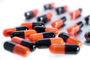 Orange and black pills capsules