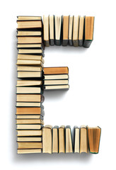 Letter E formed from the page ends of books