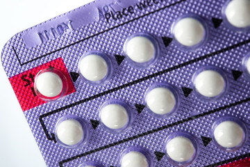 Contraceptive Pill , Hormonal pills on white