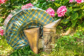 Vintage beekeeping protective hat and smoker