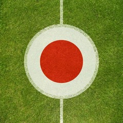 Football field center closeup with Japanese flag in circle