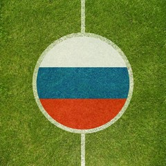 Football field center closeup with Russian flag in circle