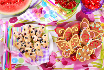 butterfly shaped gingerbread and puff pastry cookies with bluebe