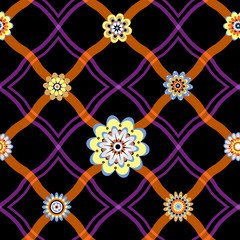 Seamless pattern with a geometrical ornament and flowers.