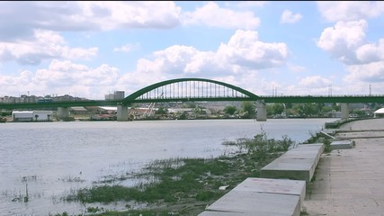 green bridge and streetcar crossing river in Belgrade, Serbia