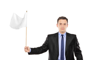 Young businessman waving a white flag