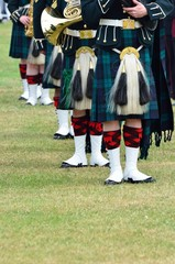 Line of musiicans in Kilts
