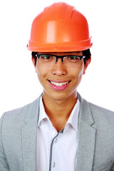 Portrait of a happy asian man in helmet over white background