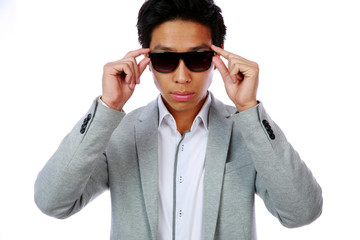 Portrait of a serious fashion asian man over white background