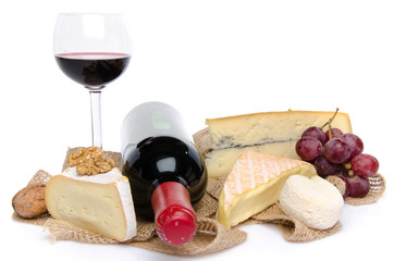 Cheeses, wine and grapes on a burlap