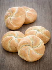 Homemade fresh bread buns  on old wooden table, selective focus