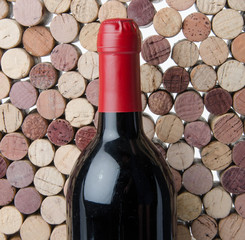 Bottle of wine on a background of corks