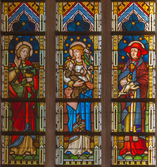 Bruges - Madonna with saints on windowpane in st. Giles church