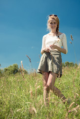 young woman in a grassland