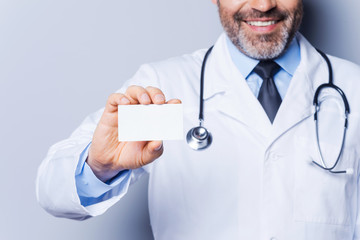 Doctor holding copy space.