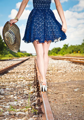 Beautiful woman walking over railroad