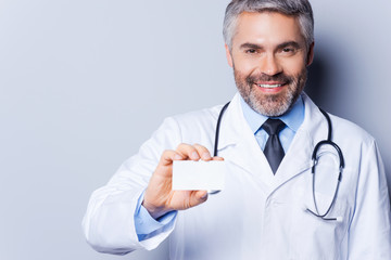 Doctor holding business card.