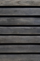 black wooden slats background
