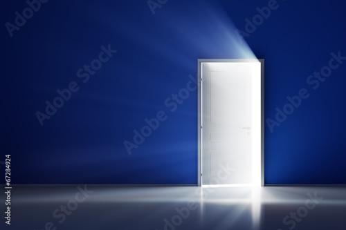 Leinwanddruck Bild Rays of light through the open white door on blue wall