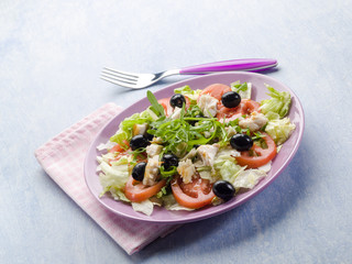 salad with fresh tuna lettuce tomato arugula and olives